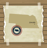 Nebraska map with stamp vintage background — Stock Vector