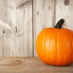 Pumpkin on table — Stock Photo #13478002