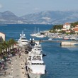 Tourists visit Old Town in Trogir, Croatia. — Stock Photo #27896875