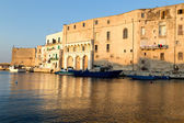 Old seaport of Monopoli its place for walking tourists.Puglia. Italy. — Stock Photo