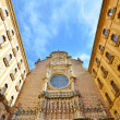 The facade of the Basilica in the Benedictine Abbey of Montserra — Stock Photo