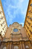 The facade of the Basilica in the Benedictine Abbey of Montserra — Stok fotoğraf