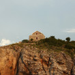 Stock Photo: Beacon on mountain in city of Budva.