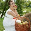 Royalty-Free Stock Photo: The bride with a basket of apples