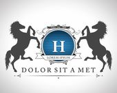 Vintage emblem with horses with a place for Your text — Stok Vektör