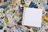 Blank Notepad on Magazine Clipping Background — Stock Photo