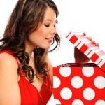 Pretty girl opens her valentines present — Stock Photo #28386859