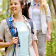 Walking outdoors with backpacks — Stock Photo