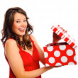 Pretty girl receives a present — Stock Photo
