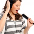 Stock Photo: Pretty girl sings along