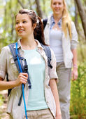 Walking outdoors with backpacks — Stockfoto