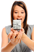 Pretty girl receives a gift — Stock Photo