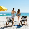 Walking honeymoon couple — Stock Photo
