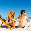 Suncare beach couple — Stock Photo