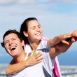 Foto Stock: Joyful couple laughing