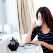 Enjoying her coffee — Stock Photo