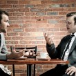 Stock Photo: Suits, coffee and conversation