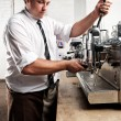 Coffee barista at work — Stock Photo