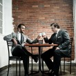 Stock Photo: Suit wearing men make deal