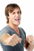 Scary man with fists clenched boxing towards camera showing agression — Stock Photo