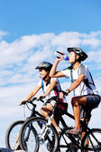 Drinking cyclist — Stock Photo