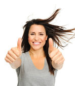 Excited brunette with thumbs up — Stock Photo
