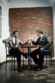 Suit wearing men make a deal — Stock Photo