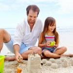 Happy sand castle child — Stock Photo