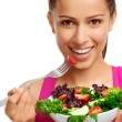 Woman enjoying salad — Stock Photo #28402521