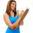 Young woman writing on clipboard — Stock Photo #28402971