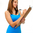 Young woman writing on clipboard — Stock Photo #28402973