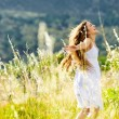 Sunset dancing meadow girl — Stock Photo #28403907