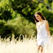 Carefree walking woman — Stock Photo #28403971