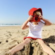 Young photographer with bright red camera — Stock Photo