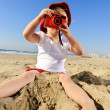 Young photographer with bright red camera — Stock Photo #28404285