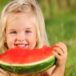 Young girl smiles with watermelon — Stock Photo