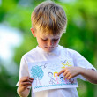Child holding drawing — Stock Photo