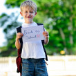 Child with paper sign — Stockfoto