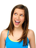 Woman looks upward and shows excitement — Stock Photo