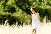 Carefree walking woman — Stock Photo