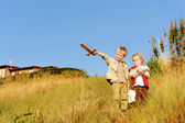 Young children playing explorers — Stock Photo