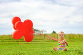 Cute girl with balloons — Stock Photo