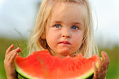 Healthy child eating watermelon — Stock Photo