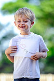 Child with paper sign — Stock Photo