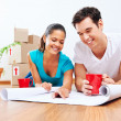 New home plans couple — Stock Photo