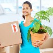 Girl moving in box — Stock Photo