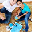 Painting couple from above — Stock Photo #28417675