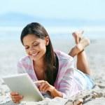 Tablet beach woman — Stock Photo #28418273