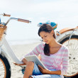 Beach bicycle tablet woman — Stock Photo