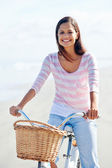 Beach bicycle woman — Stock Photo